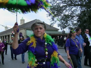 A woman dancing with her umbrella on top of her head in a pre-carnival parade in the FrenchQuarter . Wadner Pierre