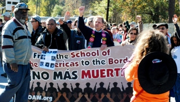 The Rev. Ismael Moreno Coto S.J., left, and the Rev. Roy Bourgeois, and founder of the School of Americas, right, lead the anti School of Americas protest in Fort Benning, Ga. This year marked the 22nd anniversary of the protest aiming to close the US-sponsored military school. Photo by Wadner Pierre