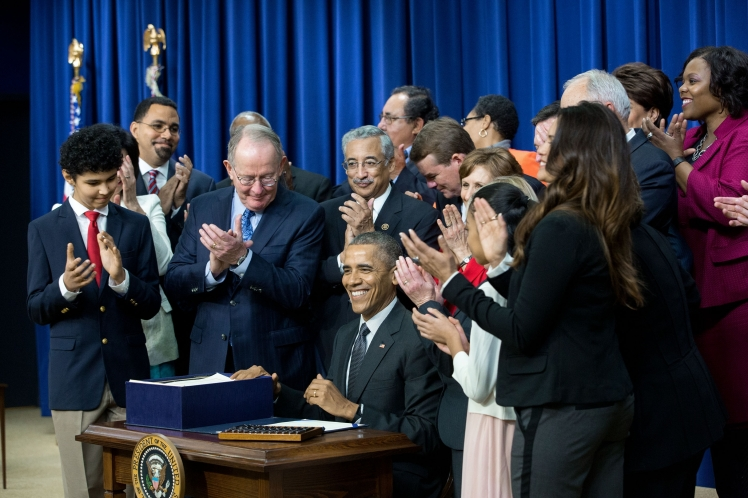 President Barack Obama signs S. 1177, Every Student Succeeds Act (ESSA), during a bill a signing ceremony in the Eisenhower Executive Office Building South Court Auditorium, Dec. 10, 2015. (Official White House Photo by Amanda Lucidon)